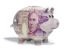 Pound note piggy bank. Piggy back covered in twenty pound note isolated on a white background Stock Image