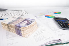 Pound notes and book. British pound bank notes and book royalty free stock image