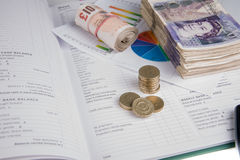 Pound notes and book Stock Photos