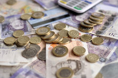 Pound notes and coins. British pound notes and coins royalty free stock photo