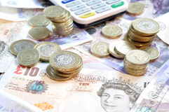 Pound notes and coins Stock Photos