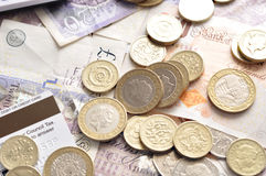 Pound notes and coins. British pound notes and coins Royalty Free Stock Photography