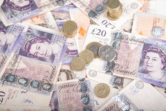 Pound notes and coins. British pound bank notes and coins royalty free stock photography