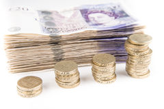Pound notes and coins. British pound bank notes and coins royalty free stock photos