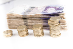 Pound notes and coins. British pound bank notes and coins stock photography