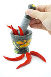 Pound Red chili with mortar. The spicy chili Pound on stone mortar Stock Photography