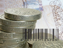 Pound for sale. Stack of pound coins overlaid with barcode Royalty Free Stock Images