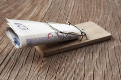Pound sterling bills in a mousetrap Stock Image