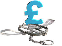 Pound sterling trap. Vulnerable pound sterling symbol precariously close to a bear trap Stock Photos