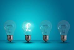 Pound symbol glow among other light bulb. Money making idea. Pound symbol glow among other light bulb on a blue background stock photography