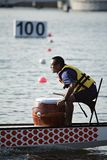 Pounding the drums in the race. 100 meters dash to the finishing line in the 1st Putrajaya International Dragonboat Race Festival Royalty Free Stock Photo