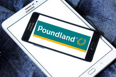 Poundland store chain logo. Logo of Poundland store chain on samsung mobile on samsung tablet. Poundland is a British variety store chain founded in 1990 that Royalty Free Stock Photo
