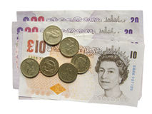 Pounds. British Pounds banknotes and coins Royalty Free Stock Images