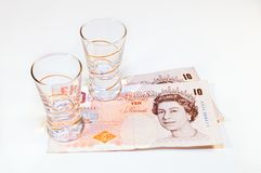 British Pounds  banknote with glass Royalty Free Stock Photo