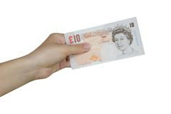 Pounds. Hand taking a banknote of 10 pounds Stock Photography