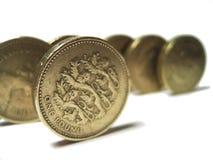 Pounds - lion. Pound coins, foucs on lion coin stock photo
