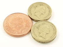 Pounds and pence. Two pounds and a two pence coin on white, isolated background stock photography