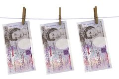 Pounds sterling on the line. With clothes pins Stock Photography