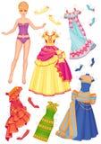 Poupée avec des robes pour la coupure Photo stock