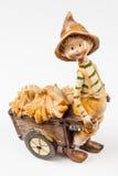 Poupée de garçon avec le chariot de maïs Photographie stock libre de droits