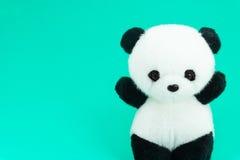 Poupée de panda noire et blanche, jante noire des yeux Photos stock