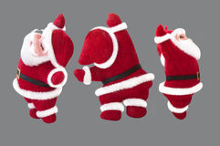 Poupée de Santa Claus sur le fond gris Image stock