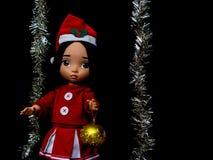 Poupée de Santy, une robe de Santa d'usage de poupée Photos libres de droits
