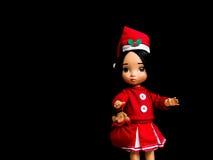 Poupée de Santy, une robe de Santa d'usage de poupée Images libres de droits