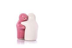 Poupée en céramique blanche et rose Projectile de studio d'isolement sur le blanc Images stock