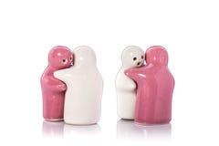 Poupée en céramique blanche et rose tir de studio d'isolement sur le backg blanc Photos stock