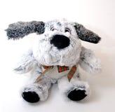 Poupée grise de chien sur le fond blanc Images stock