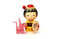 Poupée japonaise et origami traditionnels d'isolement Photos stock