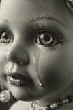 Poupée pleurante Photographie stock