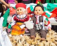 Poupées dans des costumes nationaux de Bulgare Images libres de droits