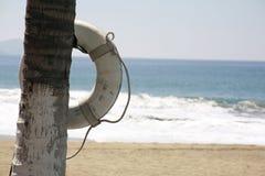 Poupança da vida da praia Fotografia de Stock