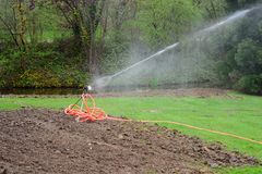 Pour. Automatic watering during the drought Royalty Free Stock Photography