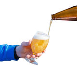 Pour beer into a glass . Royalty Free Stock Photos