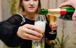 Pour champagne stock photo