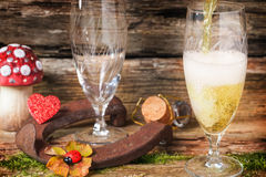 Pour champagne. In two glasses Royalty Free Stock Photos