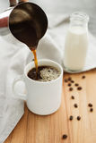 Pour the coffee into a cup. Pour a cup of coffee close-up shot Stock Image