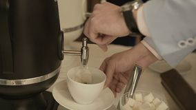 Pour the coffee into the cup.  stock footage