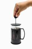 Pour coffee. A hand pouring coffee from a french-press coffee maker Royalty Free Stock Image