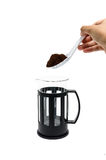 Pour coffee. A hand pouring coffee from a french-press coffee maker Royalty Free Stock Images