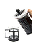 Pour coffee. A hand pouring coffee from a french-press coffee maker Royalty Free Stock Photography