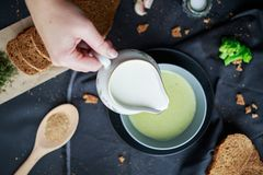 Free Pour Cream Into Cream Soup. Close-up. Milk Jug With Cream In Female Hands. Royalty Free Stock Photo - 165192785