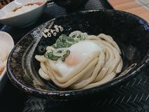 Pour `Dashi` sauce into Sanuki udon royalty free stock images