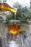 Pour the drink into a glass behind the ice surface. Stock Photo