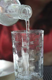 Pour drinking water. Into the glass Royalty Free Stock Photo
