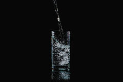 Pour into a glass. Show motion of water pour into a glass Stock Images