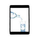 Pour into a glass of water with tablet isolated on a white backg Stock Photo